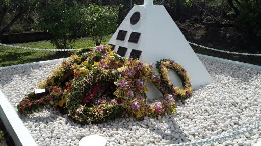 The Memorial at Rove Memorial Garden surrounded by wreaths (Photo OAG)
